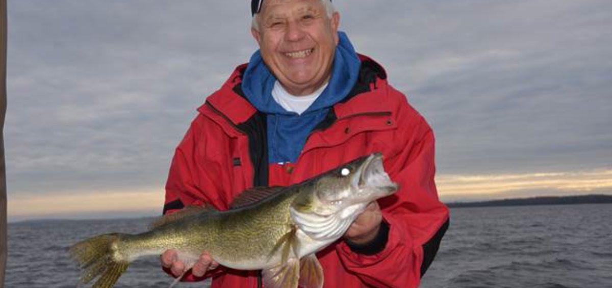 Terry Tuma holding a fish.