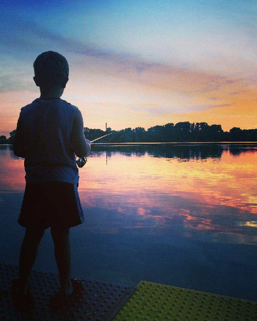 Boy Fishing at Sunset in Faribault via Aubrey O'Malley